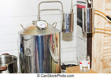 moonshine still in action, at home. alcohol mashine
