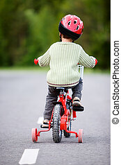 Safe Bicycling - 3 years old boy wearing safety bicycle...