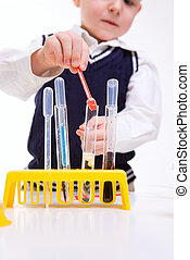 Boy practicing chemistry - Closeup of young boy performing...