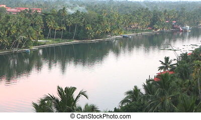 Exotic channels in Kerala. Palm trees, ships, boats, houses,...