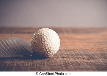 Antique golf club and ball with filter effect retro vintage...