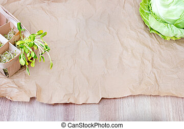 Mixed organic micro greens and cabbage on craft paper. Fresh...