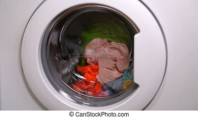 Washing machine is washing clothes - Washing machine is...