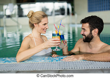 Picture of happy couple relaxing in pool - Picture of happy...