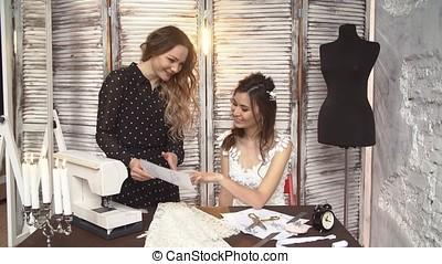 The designer negotiates a new sketch dresses