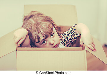 Girl out of the box - Girl popping out of a cardboard box