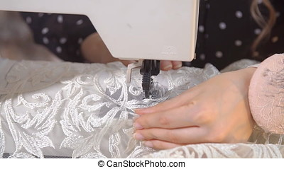 Seamstress working at sewing machine