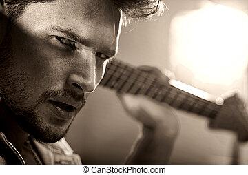 Closeup portrait of a handsome musician - Closeup portrait...