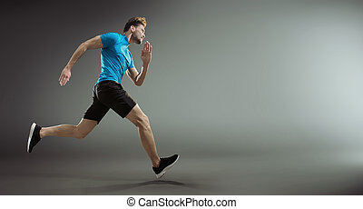 Portrait of a handsome young athlete during race