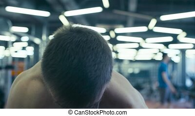 Portrait of a man lifting dumbbells in fitness studio