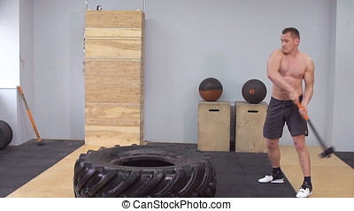 Muscular male crossfit training. Slow motion. Athlete train in the gym