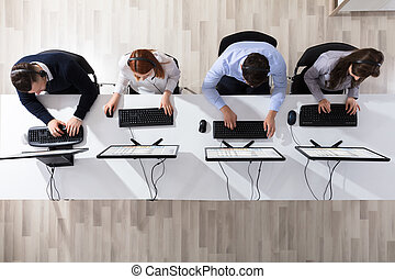 Call Center Operator Team In Office - Elevated View Of Call...