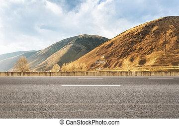 empty asphalt road in tibetan area - empty asphalt road with...
