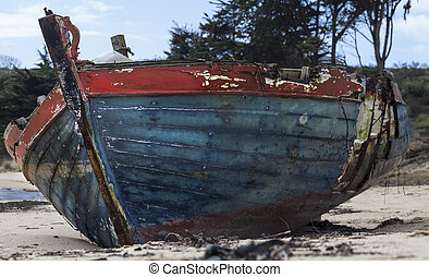 End - Small abandoned two colored fishing boat, in France