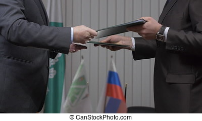 Two businessman with made a deal. Two businessmen shaking hands indicating successfully made deal