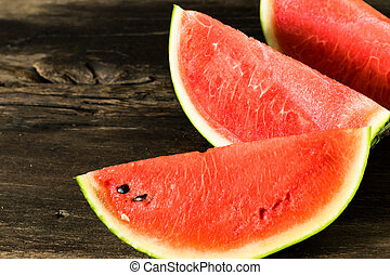 the watermelon on a rustic wooden table background
