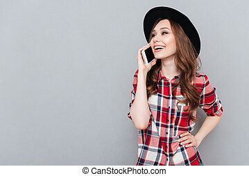 Happy young lady talking by mobile phone. - Image of happy...