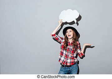 Happy young lady holding speech bubble. - Image of happy...