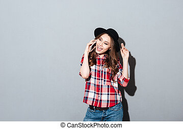 Happy young lady talking by phone - Image of happy young...