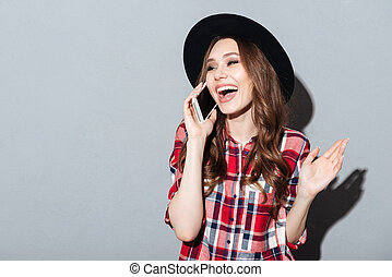 Happy young lady talking by phone. - Image of happy young...