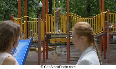 The girl is playing in the playground. - Girl child playing...