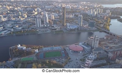 Aerial view city and sports palace. Modern city in sunset, aerial view of cityscape. Urban landscape
