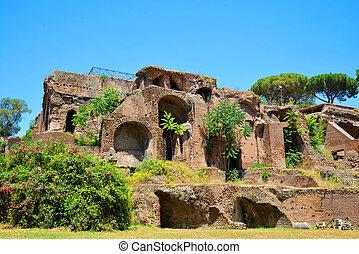 Ancient roman ruins at the Palatine Hill, Italy. - Ancient...