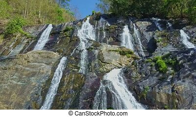 Close Wide Panorama Waterfall among Tropical Forest