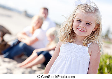 Adorable Little Blonde Girl Having Fun At the Beach