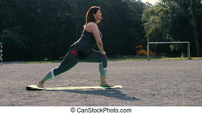 Woman doing stretches to prepare for her workout