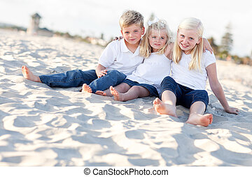 Adorable Sisters and Brother Having Fun at the Beach -...