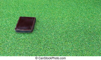 Group Wallets on grass