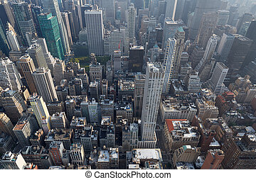 New York City Manhattan skyline aerial view with skyscrapers roof tops in a sunny day