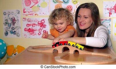 Playful family girls mom and little lovely daughter girl...