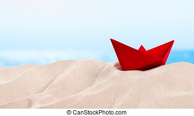 On the Beach - red paper boat on a sand dune in front of beautiful azure sea on a sunny day  - seamless loop - ProRes