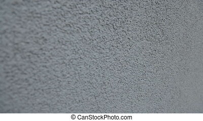 The wall is painted in gray plaster - Painted on the wall...