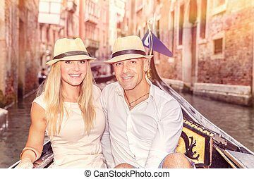 Happy couple in Venice, beautiful young people riding on the...