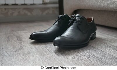 Men black shoes stand on the floor in the room - Men black...