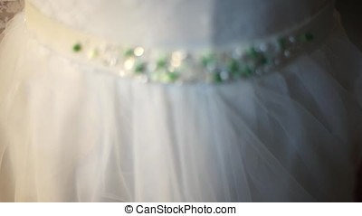 Very beautiful belt on a wedding dress made of crystals....
