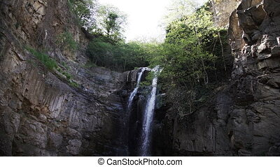 Water flowing over rocks in Tbilisi - Waterfall in mountains...