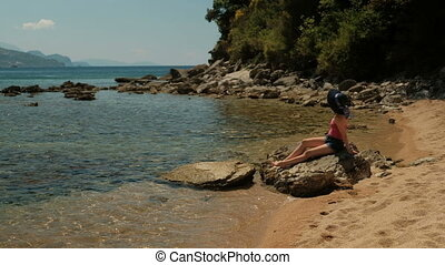 Woman lie rests sunbathing on beach on lake outdoors....