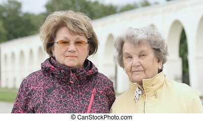 Portrait of two positive adult women outdoors