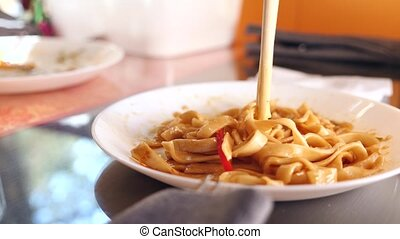 People eat Chinese food in a Chinese restaurant. close-up....