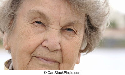 Portrait of serious old gramma aged 80s outdoors