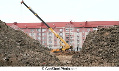 Excavator, construction crane work on construction
