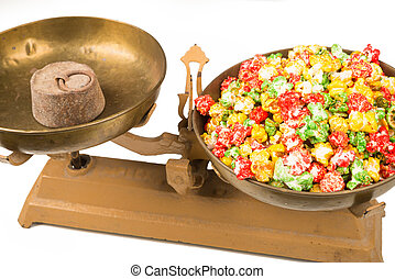 Unhealthy food concept - Colorful popcorn candy on vintage...