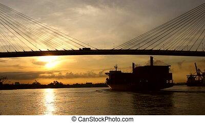 Large Cargo Shipping Boat at sunrising
