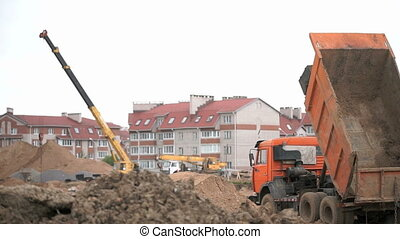 Construction vehicles and builders outdoors