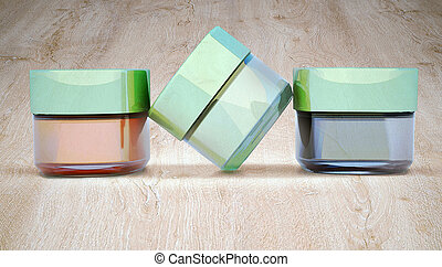 Cosmetic jars of clay, on wooden background. Three jars...