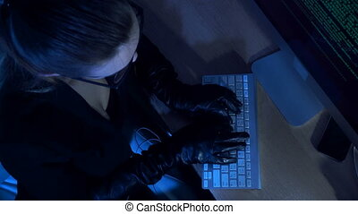 woman hacker working with computer late night